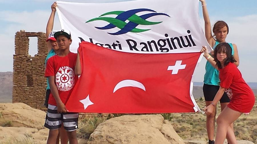 Te Aitanga a Pōkai Whenua students holding Tauranga Moana flags at Oraibi in the Hopi Nation